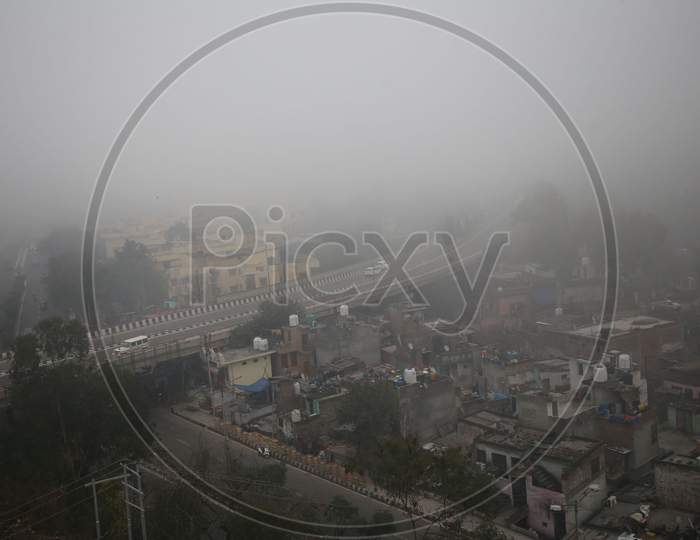 Vehicles Ply On A Road Amid Heavy Fog In Jammu,16,Jan,2021.