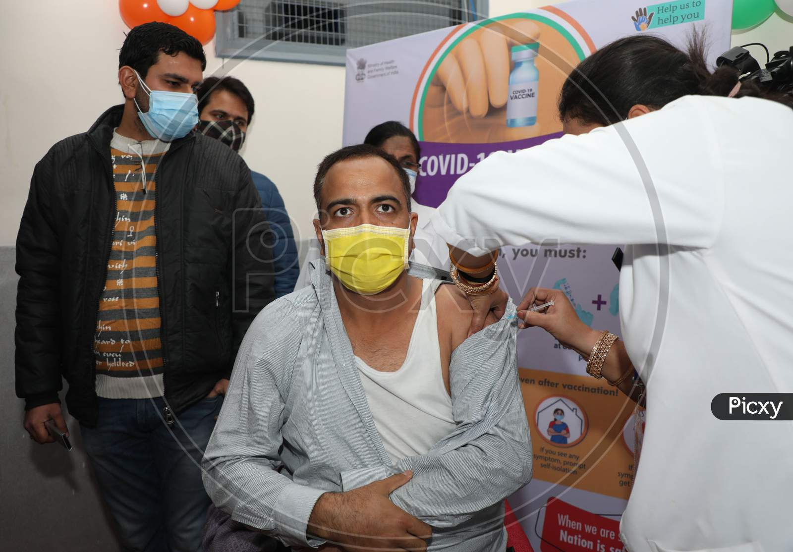 An Indian Doctor Receives A Covid-19 Vaccine At A Government Hospital In Jammu,Jan.16, 2021.