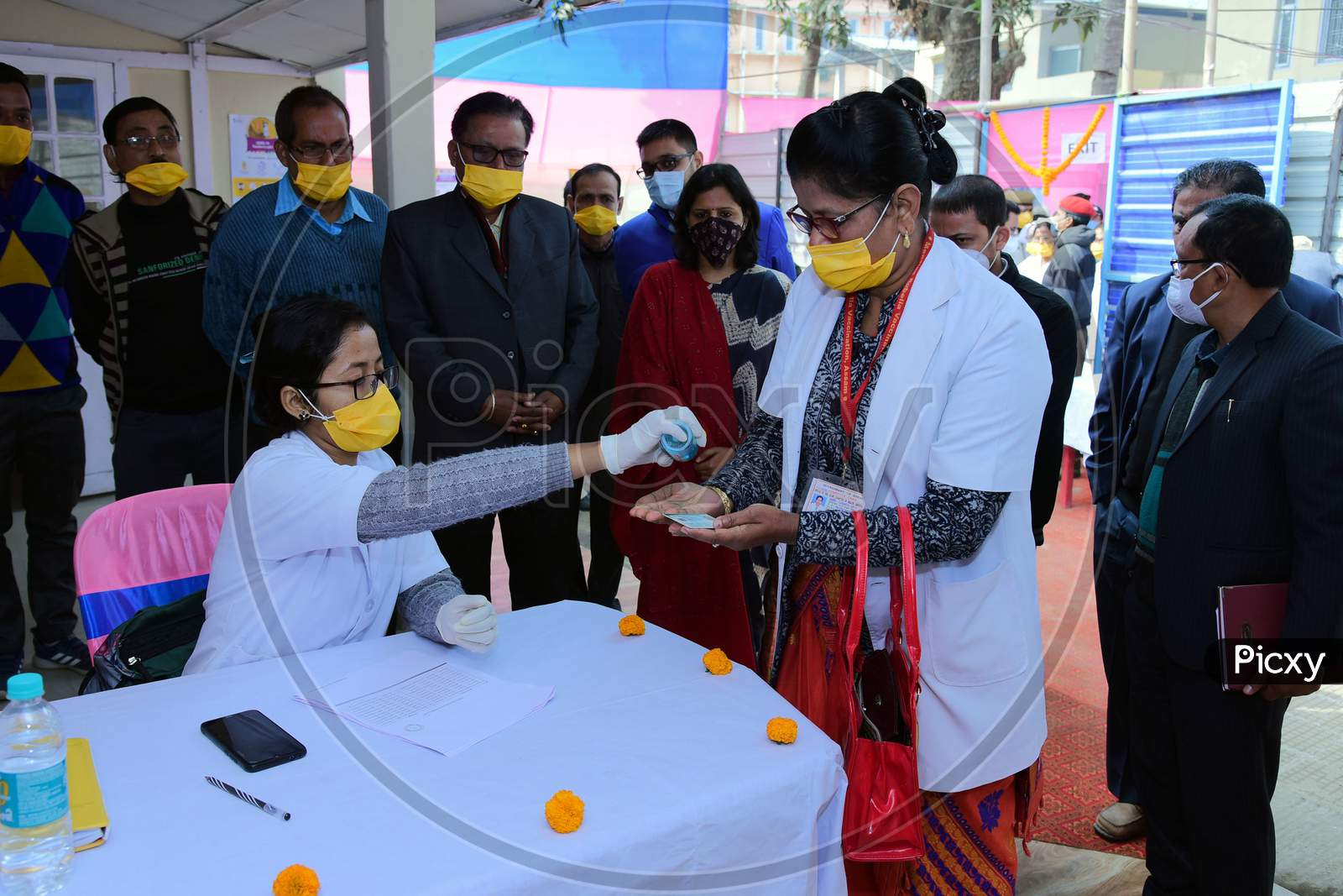 Nagaon : Health Workers  Sanitize Her Hand  Beforeb  Get Covid-19 Vaccination, After The Virtual Launch Of The Vaccine Drive By Prime Minister Narendra Modi, In At B.P Civil Hospital In Nagaon District Of Assam On Jan 16,2021.