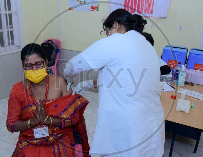 A Nurse administers the Covid-19 Vaccine to a frontline worker, after the virtual launch of Covid-19 Vaccination drive by Prime Minister Narendra Modi, at B.P bivil Hospital In Nagaon District Of Assam on Jan 16,2021.