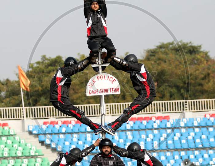 A Jammu and Kashmir policeman performs stunt on a motorcycle during the full dress rehearsal for the Republic Day celebrations, in Jammu, Sunday, Jan. 24, 2021.