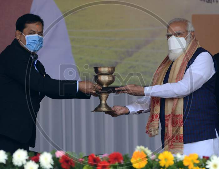 Indian  Prime Minister Narendra Modi  felicitated by Assam CM Sarabananda Sonowalduring a public meeting, at Jerenga Pathar in Sivasagar  District of Assam on Jan 23,3021