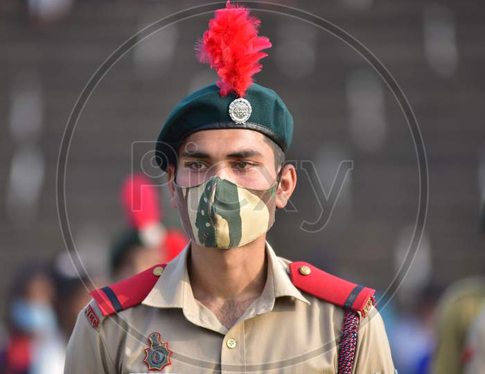 Cadet of the National Cadets Corp (NCC) wearing mask during the full dress rehearsals for the Republic Day parade in Nagaon District of Assam on Jan 24,2021.