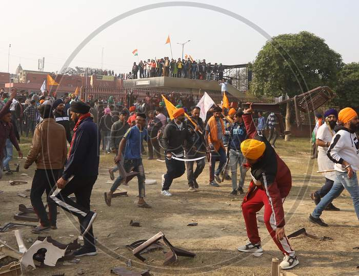 Farmers rally against agriculture reforms turned violent, after protesting farmers storm Delhi's historic Red Fort complex on January 26, 2021.