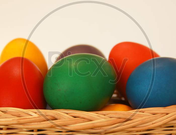 Easter Eggs Colors In Basket White Background