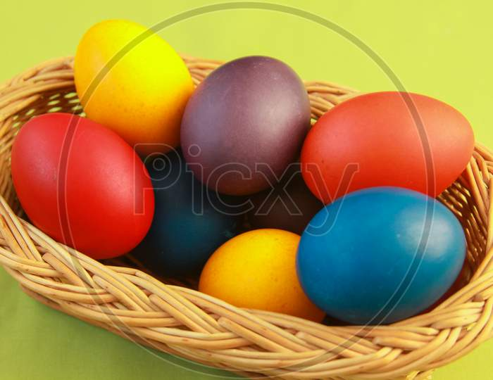 Easter Eggs Colors In Basket Green Background