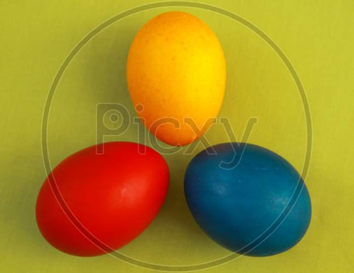 Primary Colors Easter Eggs Green Background
