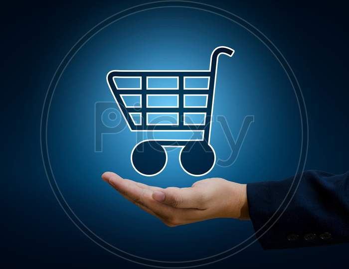 Hand Businessman Cart Shopping Technology World Digital Shopping Order Transactions On The Internet  Trading On The World Online Pay Dept. Blue Tone