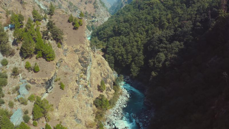 Beautiful Bhagirathi River flowing mid of two huge mountain rocks passing through stones, Surrounded by green trees and forest in Uttarkashi, Uttarakhand,india. video by chinshanfilms
