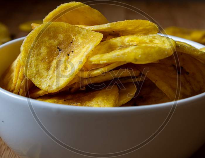 Crispy Banana Chips In A Bowl. Common Indian Savory Item