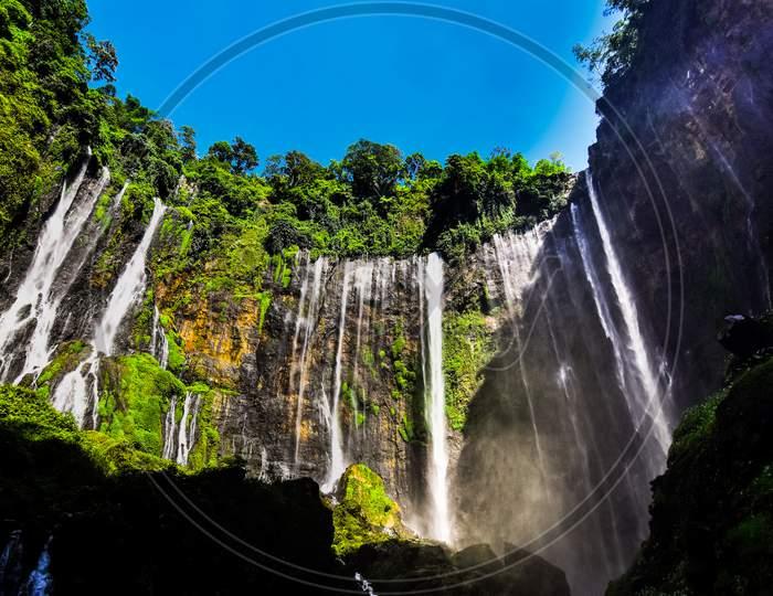TUMPAK SEWU.Panoramic beautiful deep forest waterfall in Indonesia