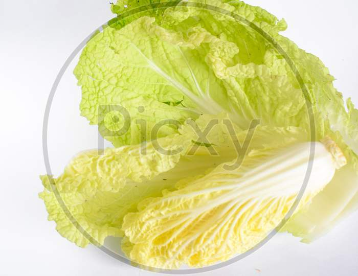 Isolated cabbage vegetables and carrots photo on white background