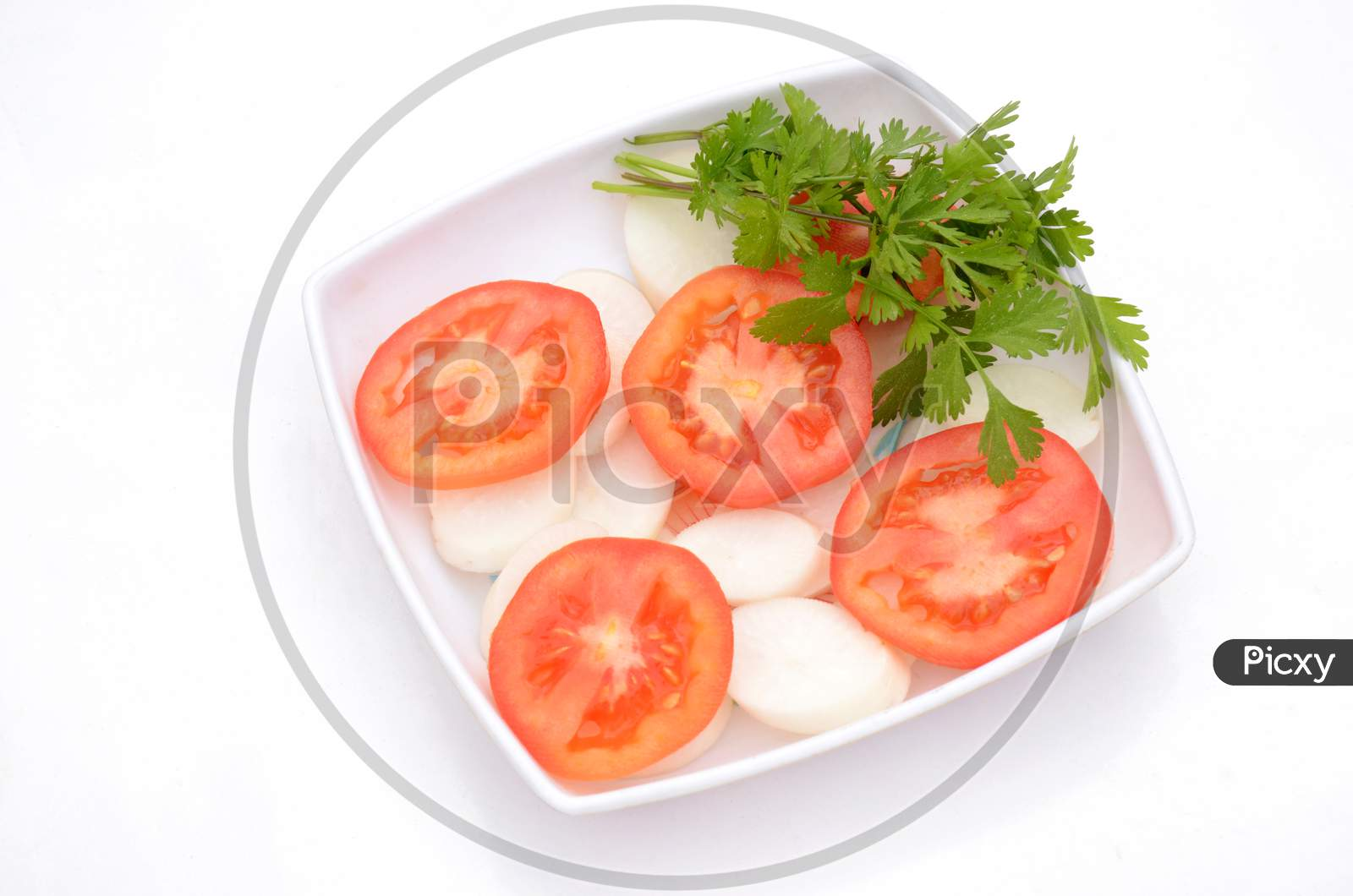 The Red Tomato With Radish Sliced And Green Coriander In The Plastic Plate Isolated On White Background.