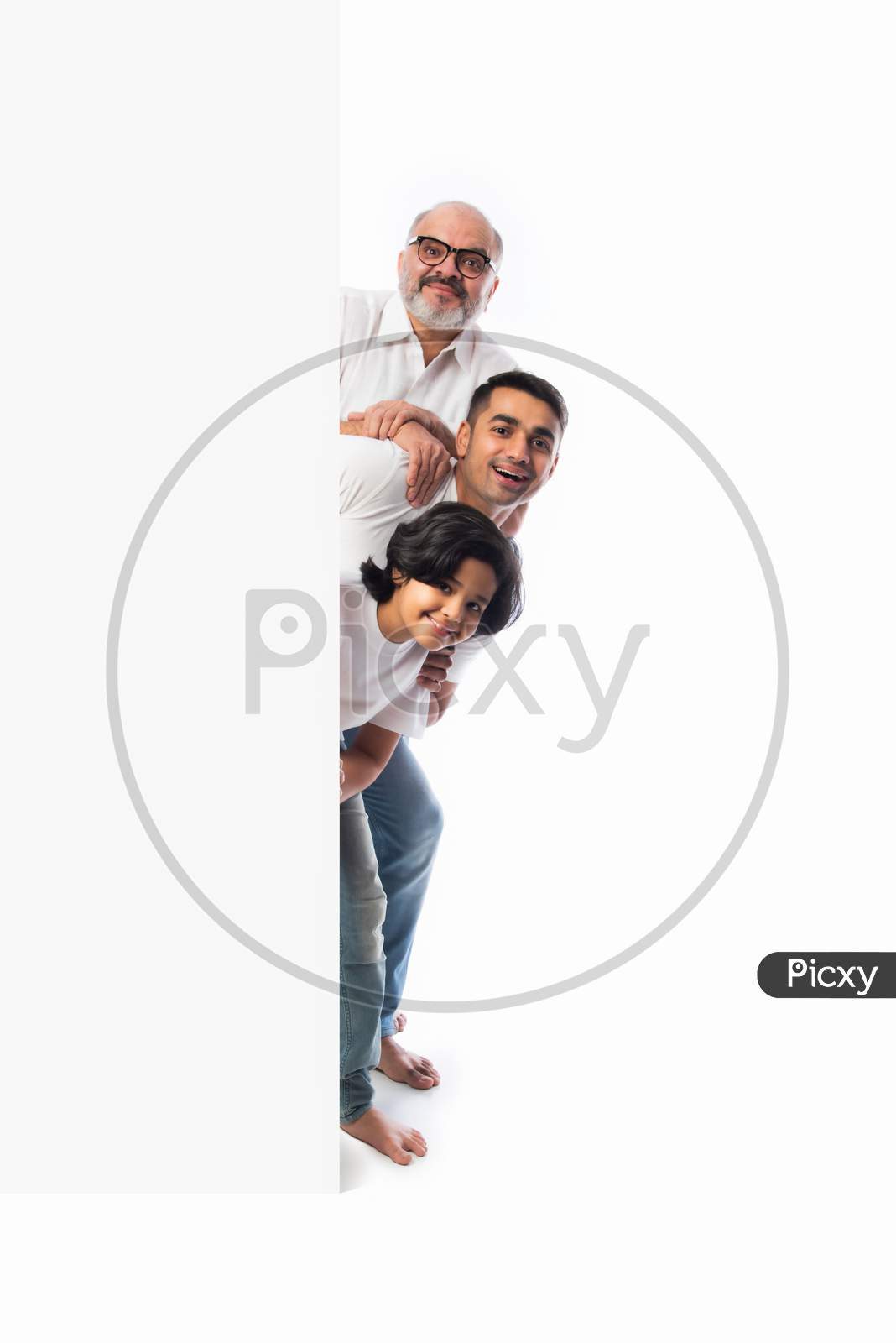 Indian Happy Family Holding Or Presenting White Board, Wall Or Placard