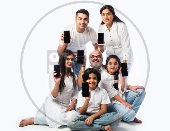 Asian Indian Family Of Six Showing Blank Or Empty Smartphone Screen