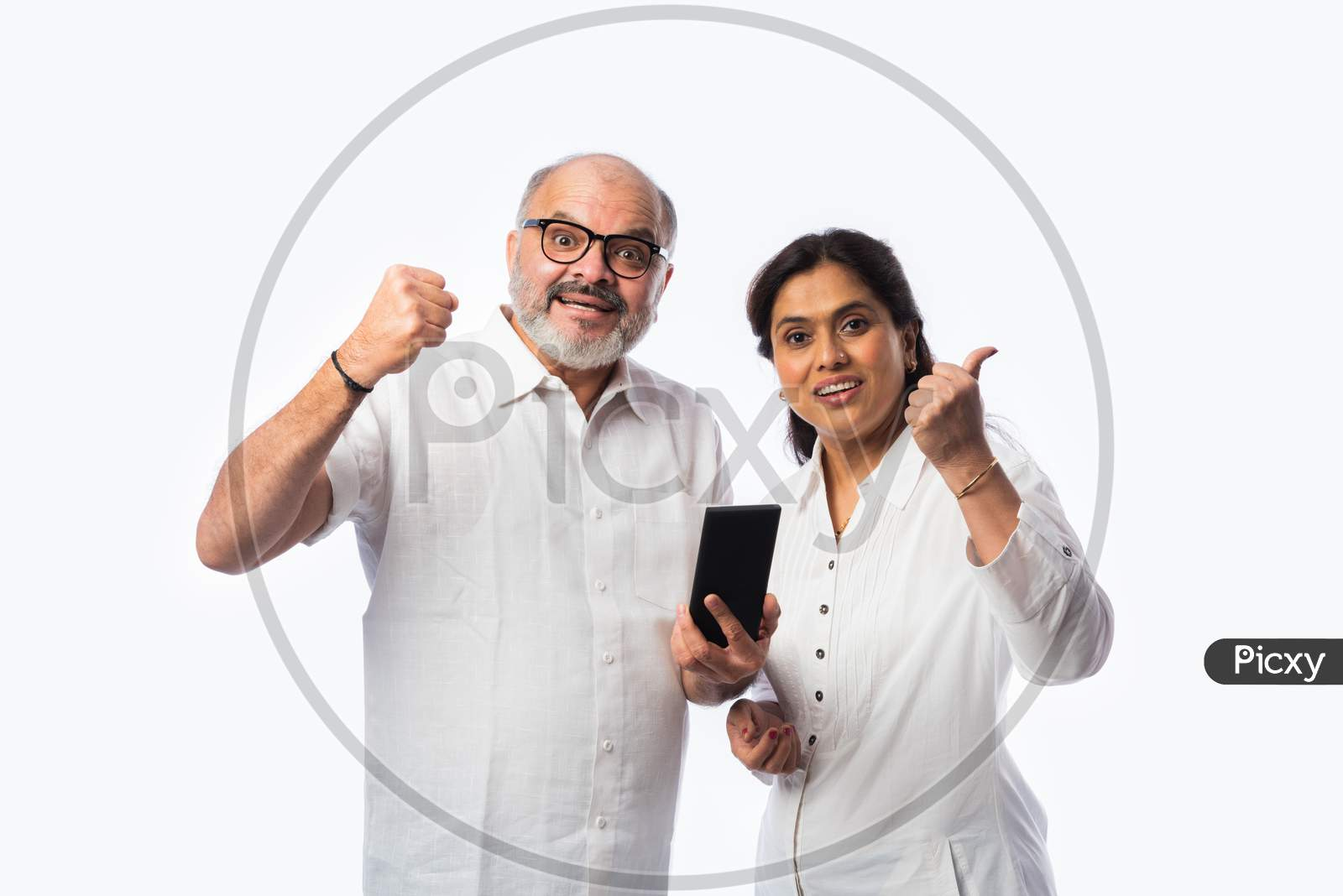 Happy Asian Indian Matured Couple Holding, Using Smartphone Against White Background