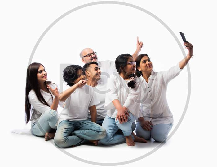 Indian Asian Multigenerational Family Using Smartphone For Selfie Or Video Calling