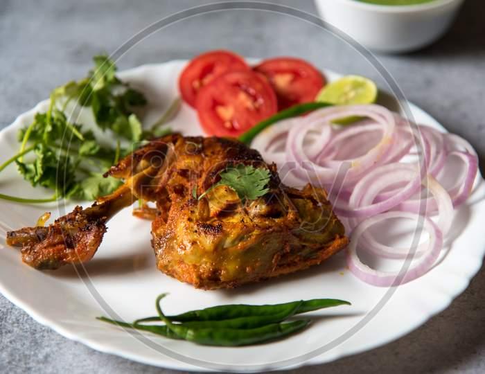 Close up of chicken tandoori in a plate