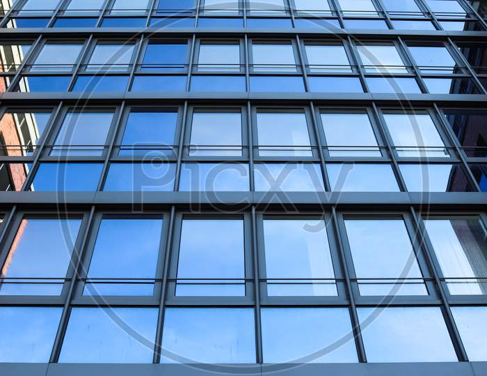 Modern Office Building Facades With Glass And Reflecting Sunlight In The Windows