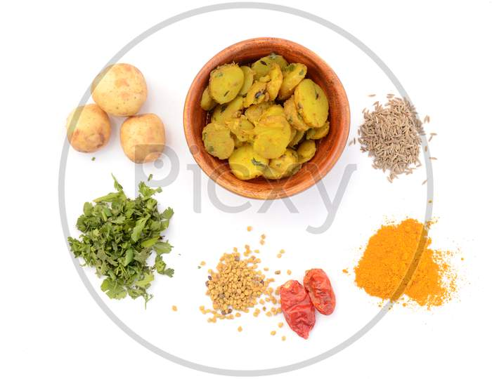 Potato Vegetable Made For With Potato, Coriander, Anise, Turmeric, Chilly, Greek, Isolated On White Background.