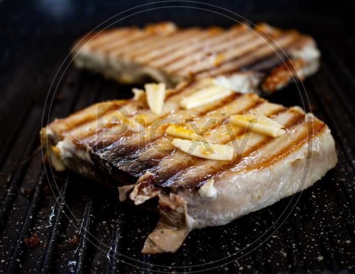 Pork Steaks Cooking On The Grill. Selective Focus. Pork Animal In Steak Seasoned With Garlic.