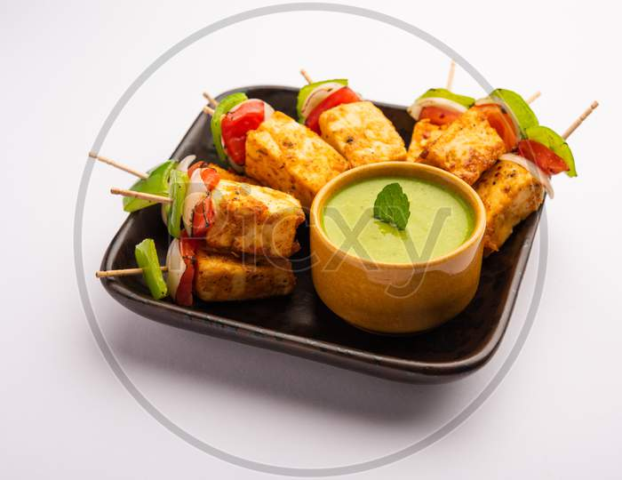 Indian Starter Snack Paneer Tikka With Spices Served With Green Chutney