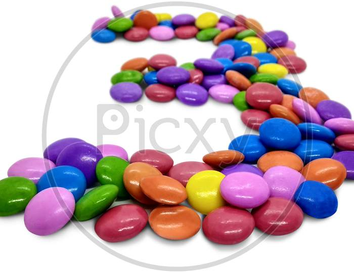 Beautiful Candy Gems on White in the shape of  Numbers, Colored sugar coated fennel seed isolated on white