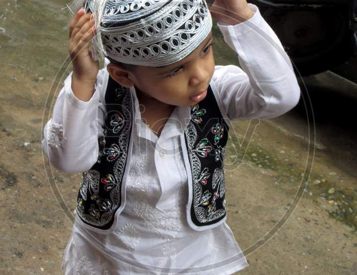 Indian Mohammedan walking in street on the occasion of Eid