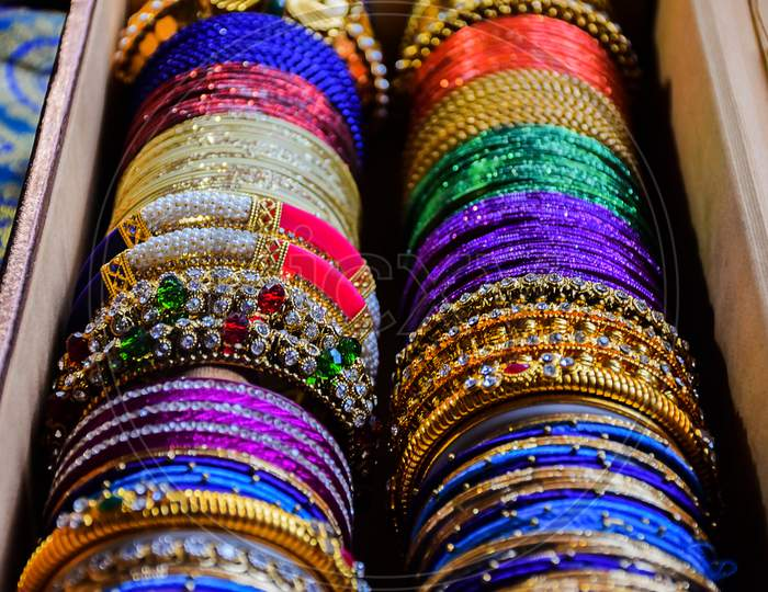 Stock Photo Of Indian Traditional Colorful Bangles And Bracelet Kept And Decorated In Bangle Box On Red Background, Focus On Object At Bangalore Karnataka India.