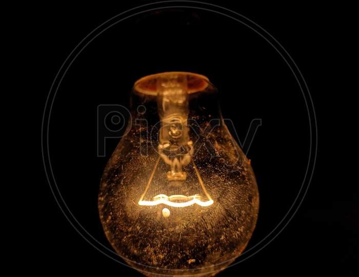 Old vintage light bulb glowing dim