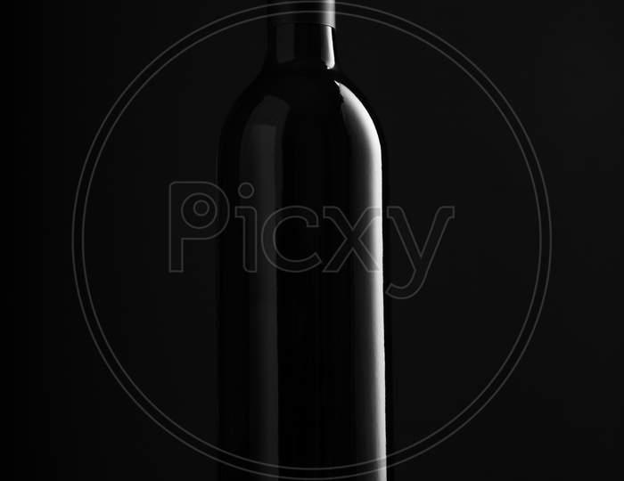 Red Wine Bottle On Black Background