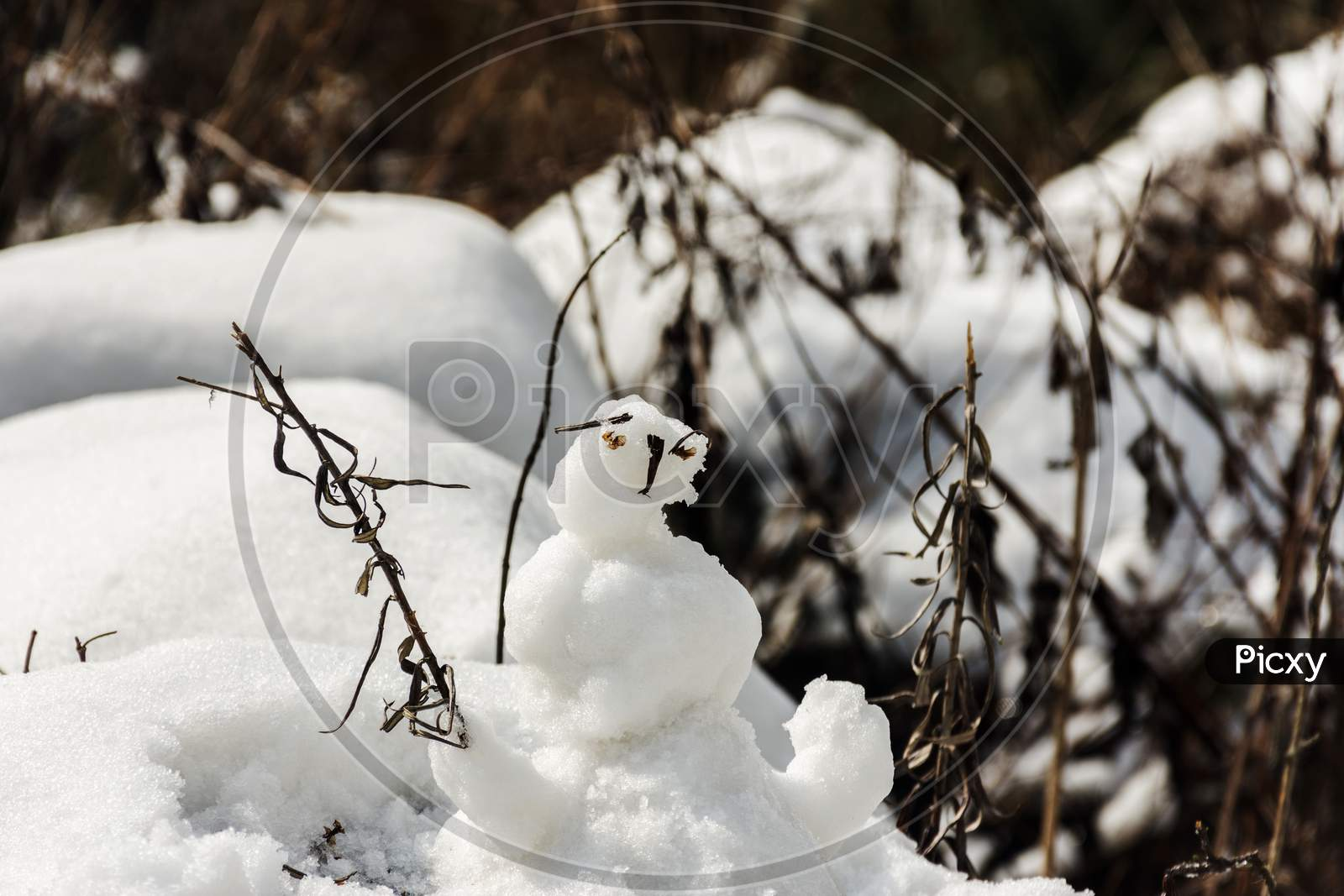 Tourist Made Small Snow Man With Ice While After Snowfall.