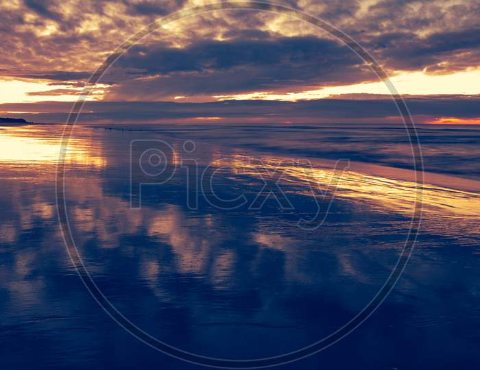 Incredible Colors During Sunrise. Reflections In The Sea Water. Holiday Landscape.