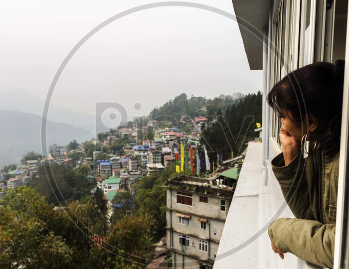 A Young Female Tourist Enjoying The View Of Beautiful Gangtok The Capital City Of Sikkim.