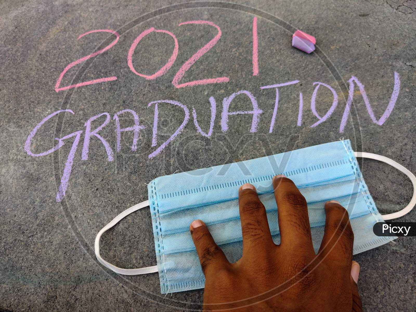 The Inscription Text On The Grey Board, 2021 Graduation Using Color Chalk Pieces And South Indian Male Hands On Surgical Mask