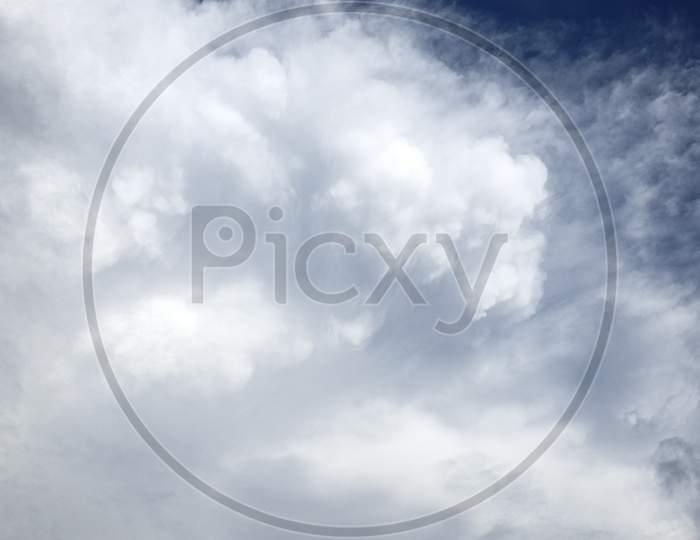 A Cumulonimbus Cloud. White Clouds In The Blue Sky