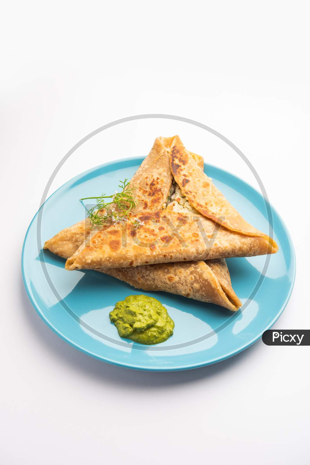 Indian Food Triangle Shape Paratha Wrap Served With Chutney