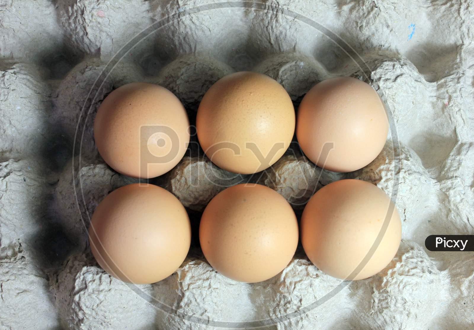 Brown Eggs On The Carton Stock Photo