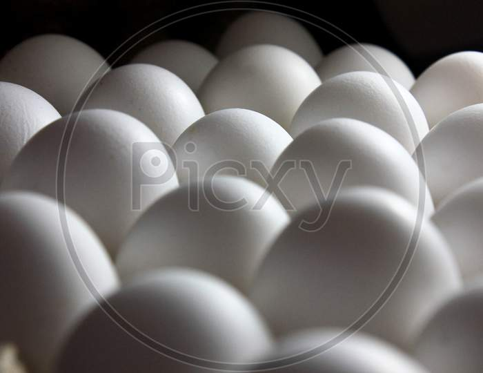 Farm Fresh White Egg On The Stacked Stock Photo