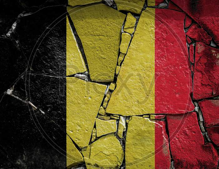 National Flag Of Belgium  Depicting In Paint Colors On An Old Stone Wall. Flag  Banner On Broken  Wall Background.