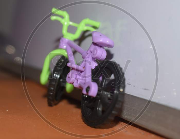 small toy cycle placed with white background
