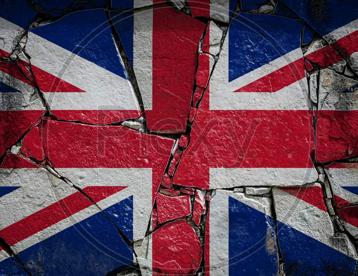 National Flag Of United Kingdom Depicting In Paint Colors On An Old Stone Wall. Flag  Banner On Broken  Wall Background.