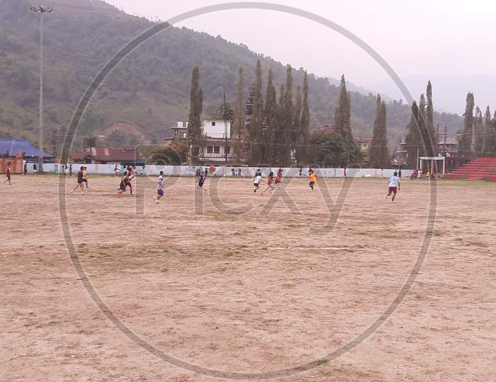 Football players in a Football match at Seppa General Ground at Seppa