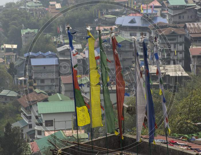 Multicolored Prayer Flags And Gangtok City In Background.