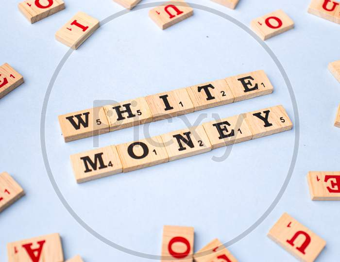Assam, india - March 30, 2021 : Word WHITE MONEY written on wooden cubes stock image.