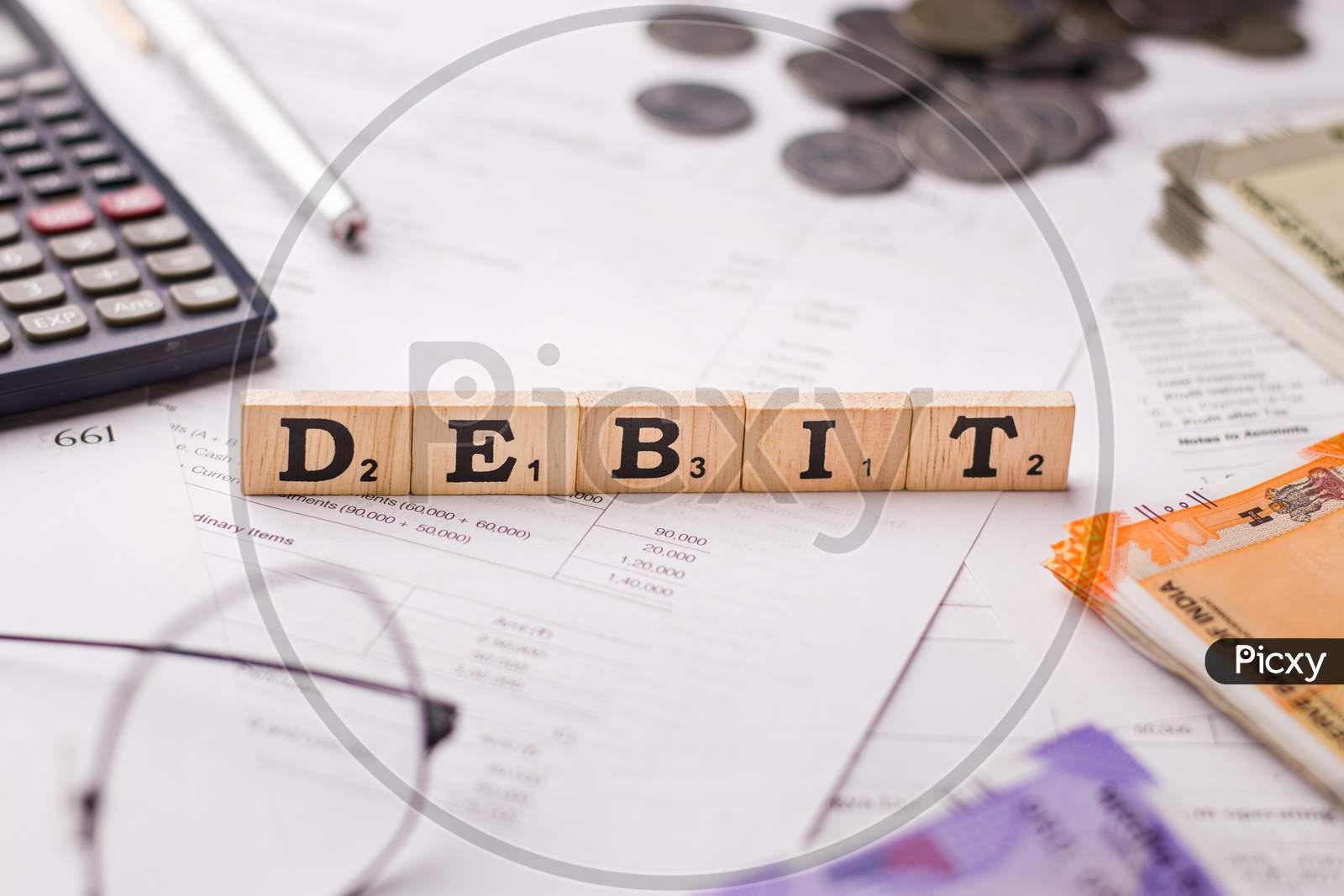 Assam, india - March 30, 2021 : Word DEBIT written on wooden cubes stock image.