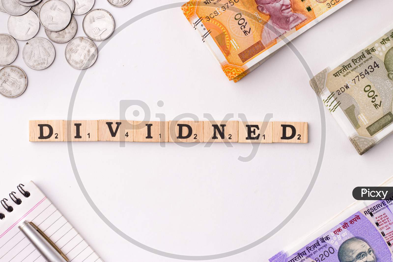 Assam, india - March 30, 2021 : Word DIVIDEND written on wooden cubes stock image.