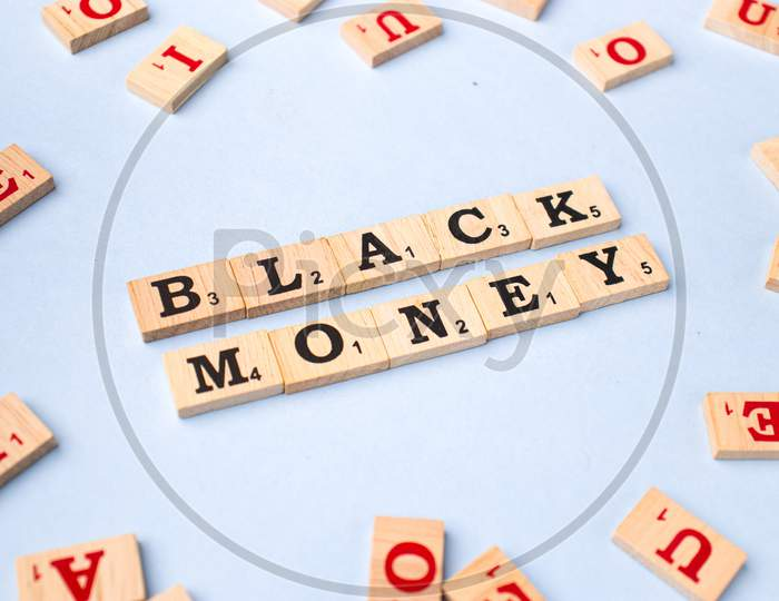 Assam, india - March 30, 2021 : Word BLACK MONEY written on wooden cubes stock image.