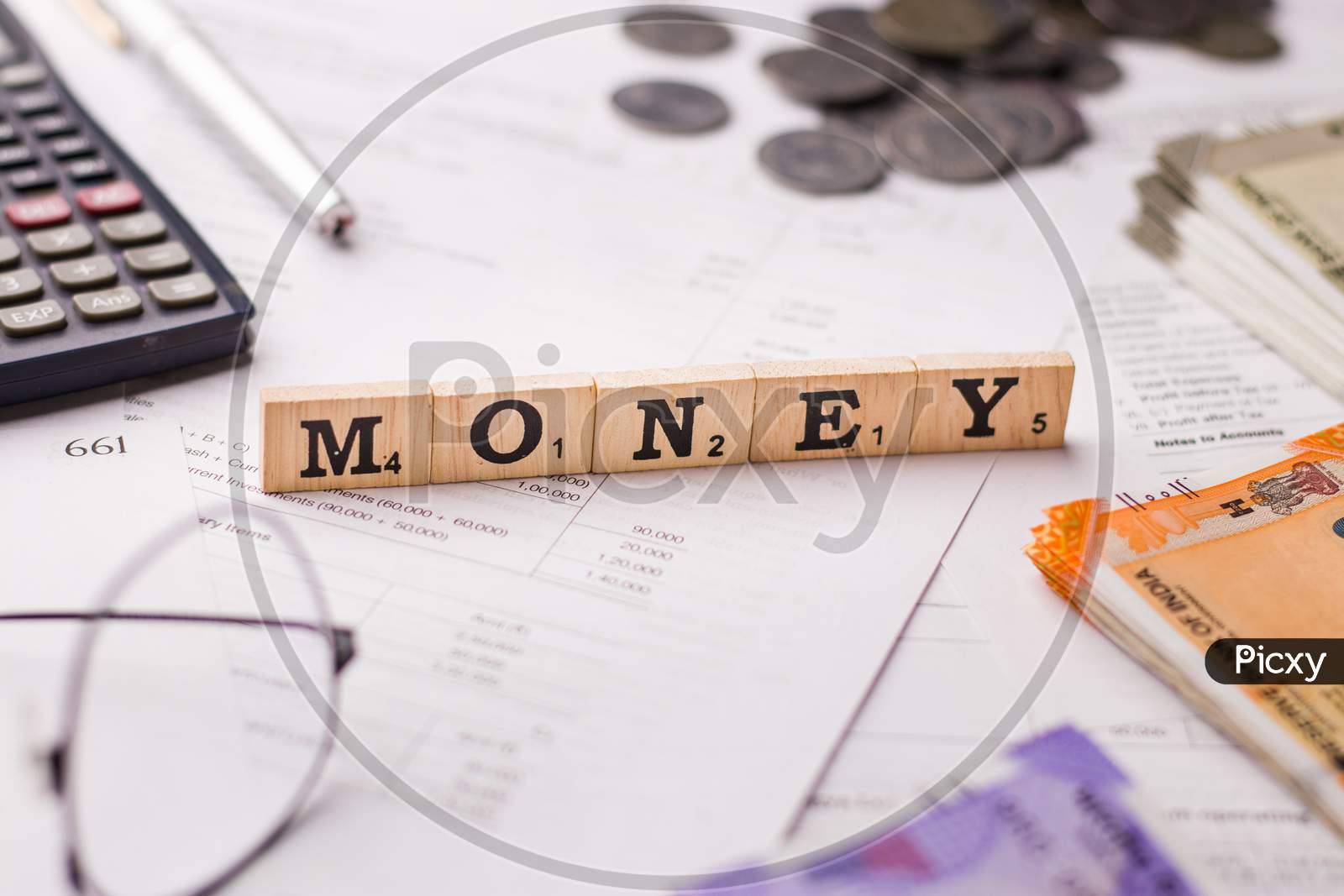 Assam, india - March 30, 2021 : Word MONEY written on wooden cubes stock image.