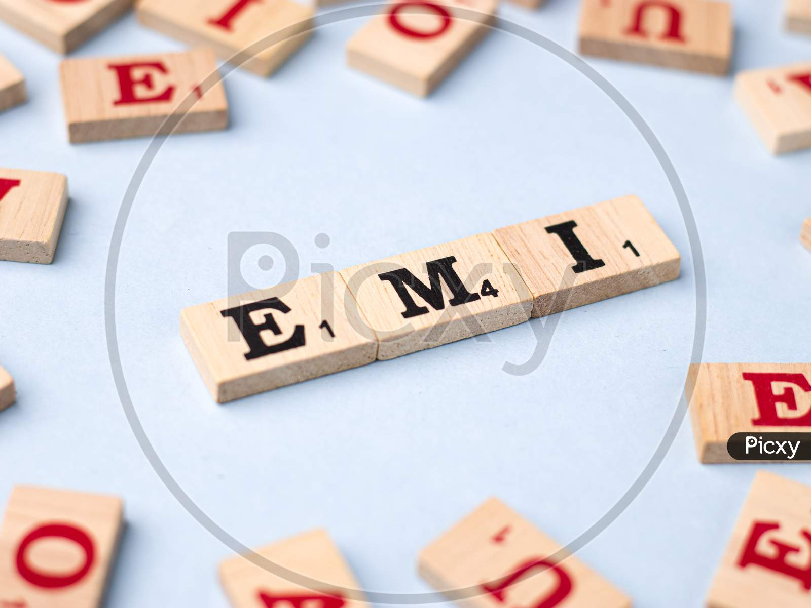 Assam, india - March 30, 2021 : Word EMI written on wooden cubes stock image.